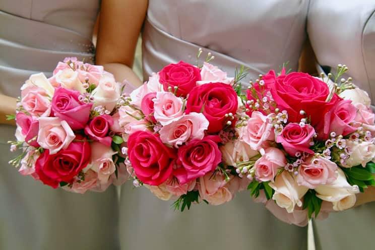 Bridemaids holding flower bouquets