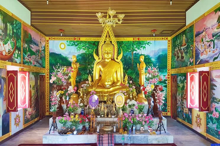 Buddhist temple with large gold Buddha statue in the center