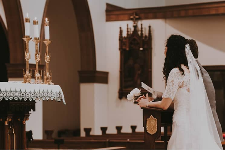 couple at the altar in catholic church