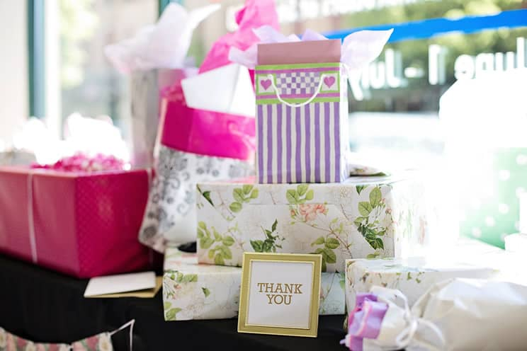 Wedding presents on table with thank you card